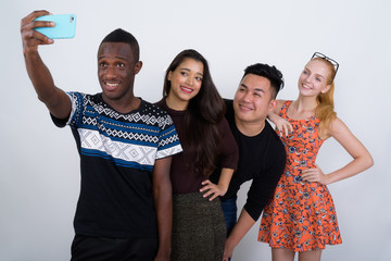 Studio shot of happy diverse group of multi ethnic friends smili
