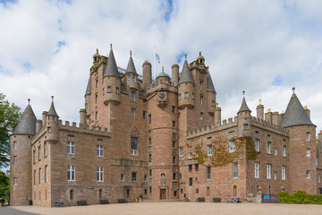 Glamis Castle in Angus, Scotland, United Kingdom. Glamis Castle is situated close to the village of Glamis and is the home of the Earl of Strathmore and Kinghorne.