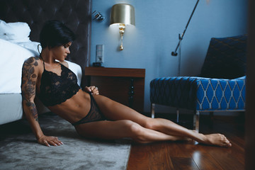 Beautiful sensual woman in lingerie in bedroom