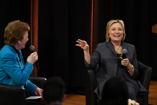 Former US Secretary of State Hillary Clinton speaks with former President of Ireland, Mary Robinson during a public lecture at Trinity College Dublin