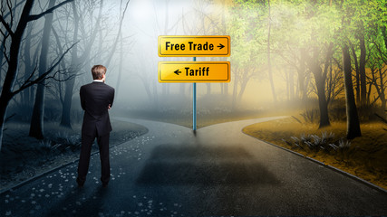 "Businessman stands on crossroad between ""free trade"" and ""tariffs"""