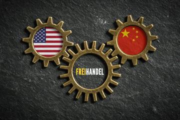 Zahnräder auf Schiefertafel symbolisieren Freihandel zwischen USA und China
