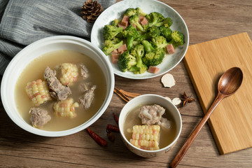 Bone soup with wood grain background