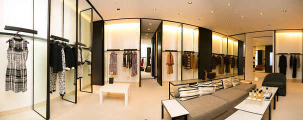 fashionable interior of boutique in modern mall.