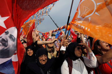 Supporters of Turkish President Tayyip Erdogan attend an election rally in Istanbul