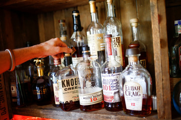Bourbon whiskey is displayed at the World's End pub in London, Britain