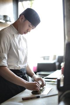 Japanese chef rolling sushi
