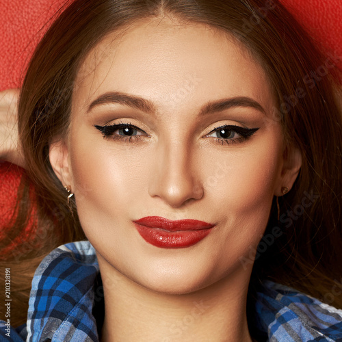 b5fbf82d8b7154 ... caucasian woman dressed in blue checkered shirt smiling and posing with  her hands behind head. Gorgeous long haired female model with red lips and  black ...