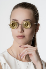Beautiful girl in glasses from bitcoin