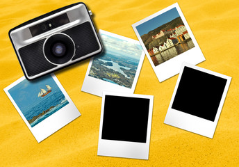 Oldfasioned camera and photo frames cards on yellow sandy background