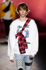 A model presents a creation by designer Mike Amiri as part of his Spring/Summer 2019 collection show for Amiri label during Men's Fashion Week in Paris