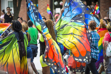 Foto op Plexiglas Carnaval Gay pride carnival parade participants wearing colorful rainbow butterfly wing costumes in Greenwich Village