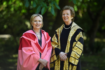 Former US Secretary of State Hillary Clinton poses for a photograph with University Chancellor and Former President of Ireland Mary Robinson before being recognised with an honorary degree of Doctor of Laws at Trinity College Dublin