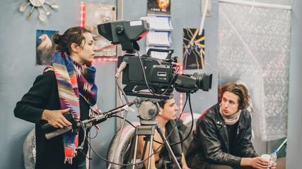 Behind the scene. Film crew filming movie scene in studio
