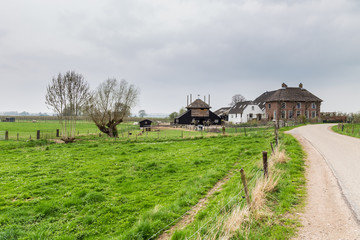 Tradiitional Dutch  farmhouse and haystack near Maurik in the Neteherlands