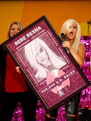 Singer Bebe Rexha is presented with a Gold record for selling 500,000 units during an appearance on ABC's 'Good Morning America' show in New York