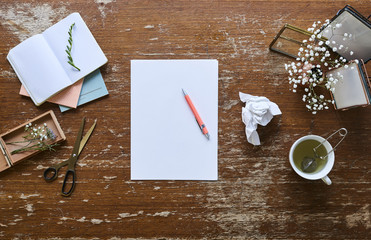 writing a letter on individual and inspirational workspace flowers and pictures