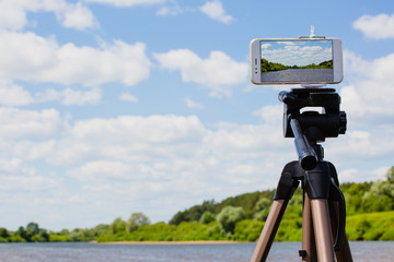 Using smartphone like professional photo camera on tripod