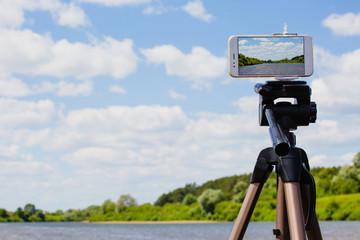 Using smartphone like professional photo camera on tripod