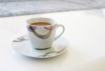 White cup of great coffee with saucer