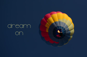 Dream on concept. Hot air balloon colorful in sky