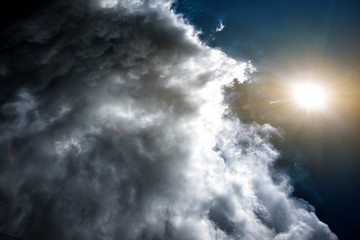 Confrontation of the weather: the sun and the clouds. Concept: the confrontation between people.