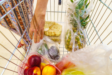 Shopping cart with grocery items at supermarket