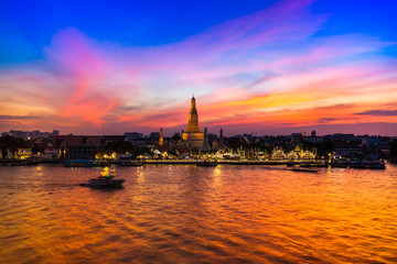 "A colorful of sunset time reflection of gold pagoda ""Wat Arun"" temple of Bangkok at night time"