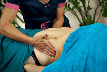 Massage with hands on a bare body