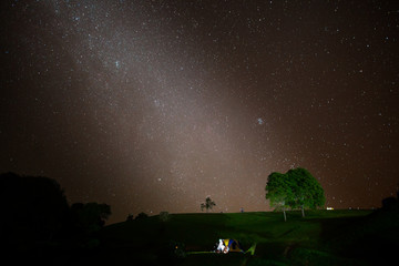Night sky of milky way with tree located north of thailand