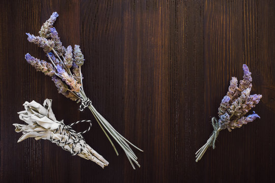 Dried Lavender and Sage on Dark Wood Table