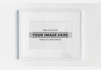 White Framed Print on Textured Wall Mockup