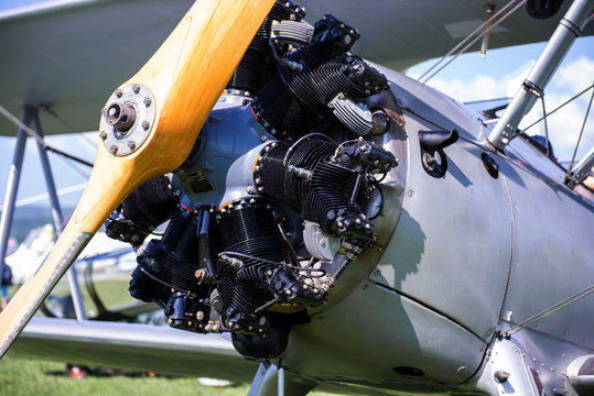Vintage aircraft with radial engine and wooden propeller, close up of nose section