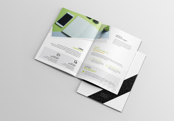 White Brochure Layout with Black and Green Design Elements