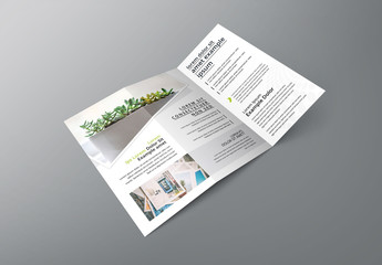 White Trifold Business Brochure with Black and Green Design Elements