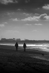 Black & White - People Walking Down The Beach