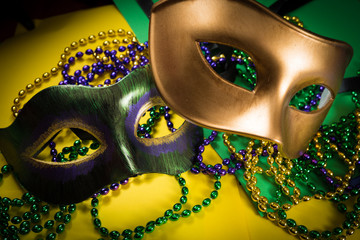 Wall Mural - Mardi Gras mask with beads on a yellow background