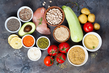 Organic Healthy food Clean eating selection Including Certain Protein Prevents Cancer on a dark stone backgound