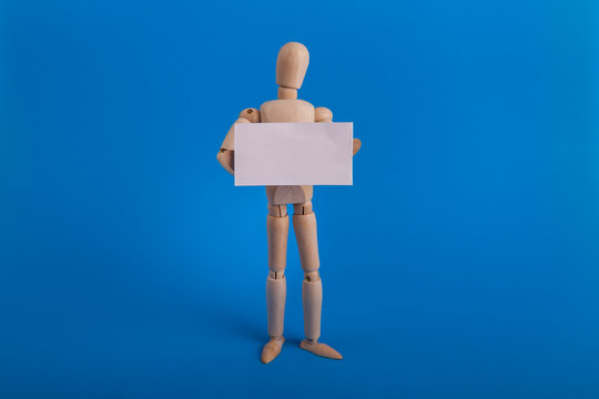 Wooden manikin holding blank white sign just add text