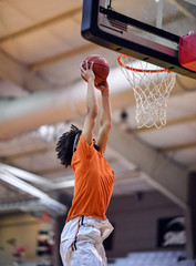 Athletic High School Basketball Player Making a Slam Dunk