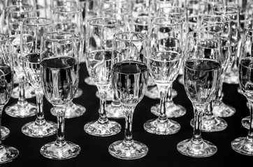 Glasses with champagne in black and white colors