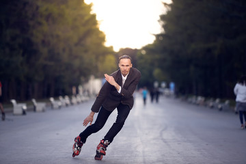 the guy in the business suit is riding on rollers. fast driving technique