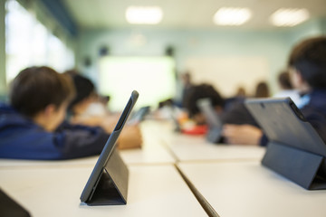 children study in class with their tablet