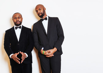 two afro-american businessmen in black suits emotional posing, g