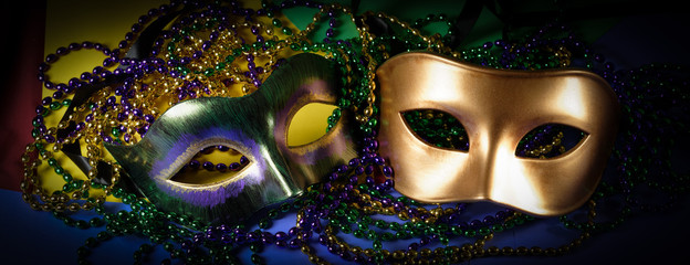 Wall Mural - multiple Mardi Gras masks on a dark background