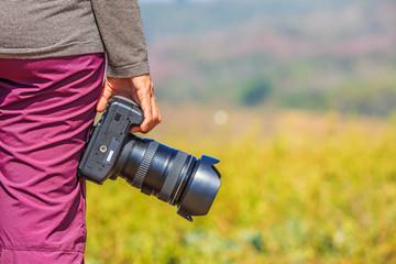 Photographer holds her DSLR camera