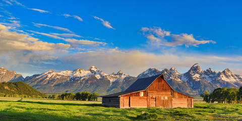 This abandoned, vintage barn in Mormon Row has the Grand Tetons in the background.  Located in Jackson Hole, Wyoming, it is listed on the National Register of Historic Places.