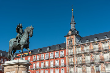 The Statue of King Philip III and the beautiful buildings at the Plaza Mayor in Madrid, Spain