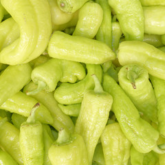 organic green horn peppers top view, food background
