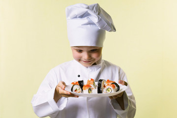 funny boy chef cooked sushi on a plate